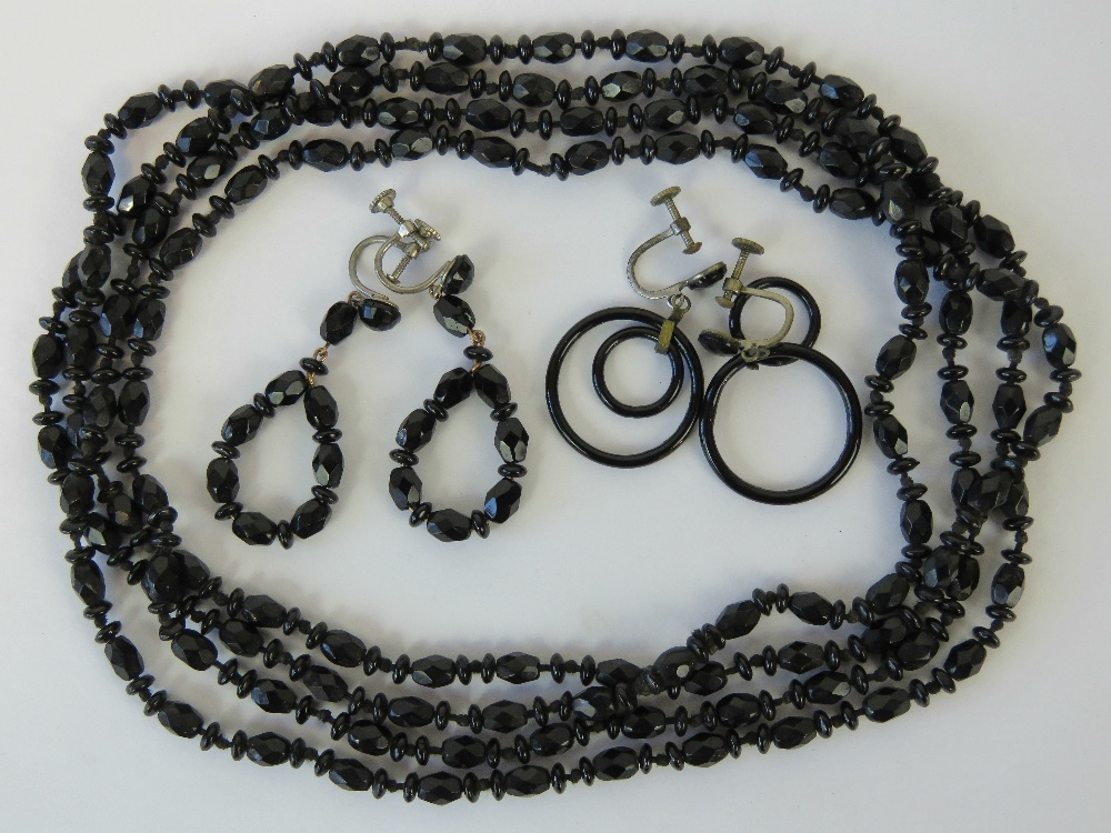 Lot 90 - A long French jet necklace with two pair