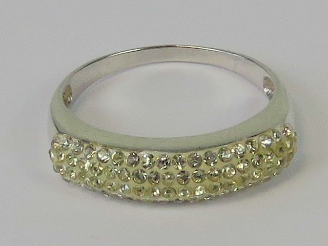 Lot 70 - A silver ring encrusted with white stone