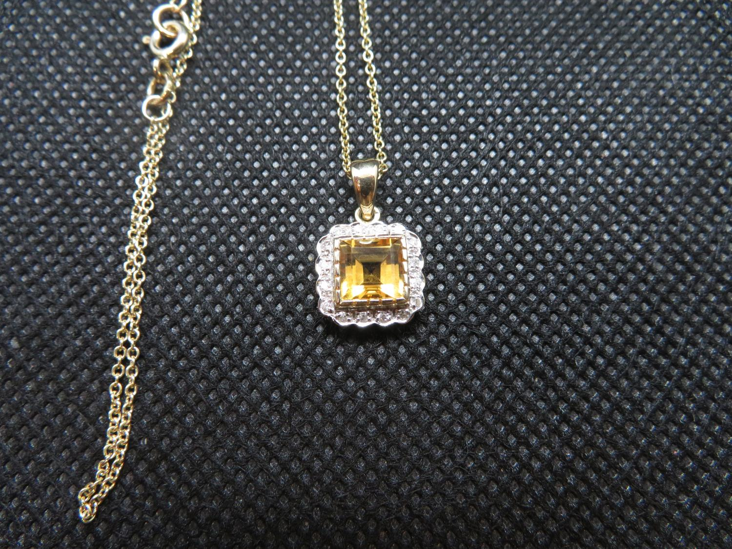 """Lot 1 - 9ct gold citrine and diamond pendant on 18"""" 9ct gold chain"""