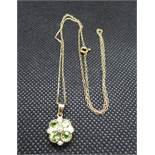 9ct gold peridot and pearl pendant on 9ct gold chain