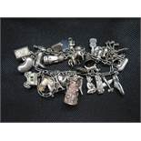 Vintage silver figaro link bracelet with 30 charms 79 grams