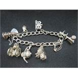 Vintage silver charm bracelet with 8 nice quality charms HM Birmingham 1965 49g