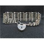 Silver 7 bar gate bracelet with padlock and chain HM London 1975 19g