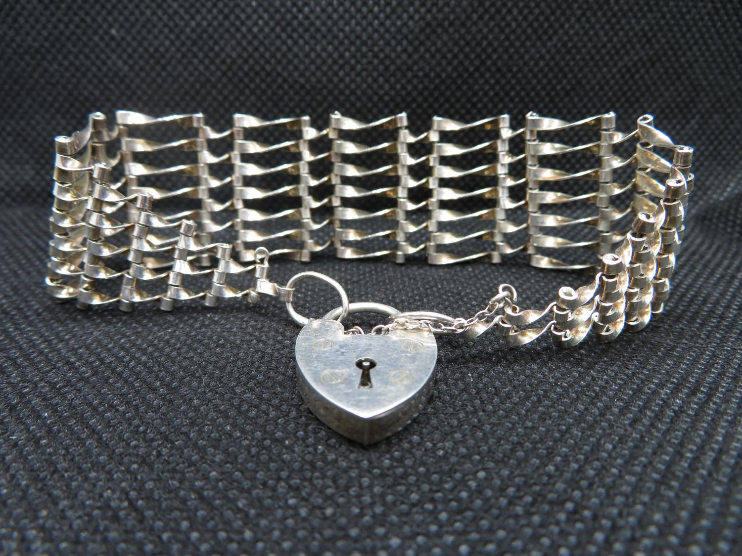 Lot 45 - Silver 7 bar gate bracelet with padlock and chain HM London 1975 19g