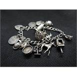 Vintage silver bracelet George Jensen 15 charms padlock and safety chain 58g
