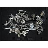 Vintage silver double link charm bracelet with padlock and chain approx 20 charms HM Birmingham 1988