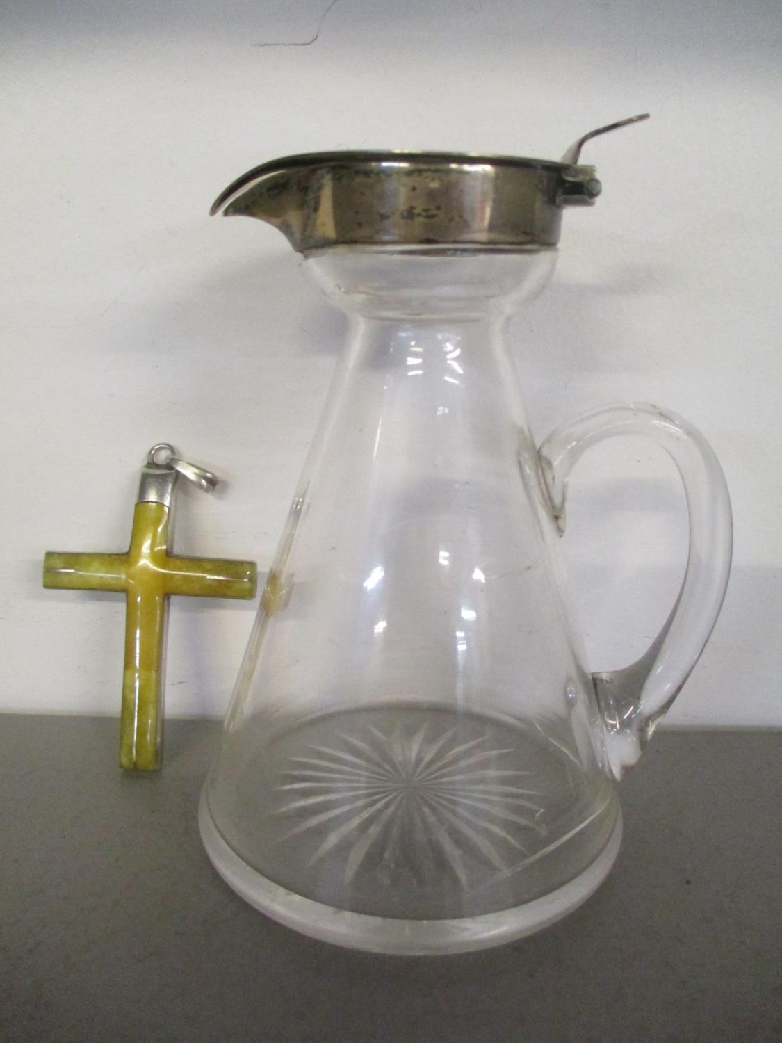 An early 20th century silver topped whisky noggin, together with a silver backed cross, inset with a