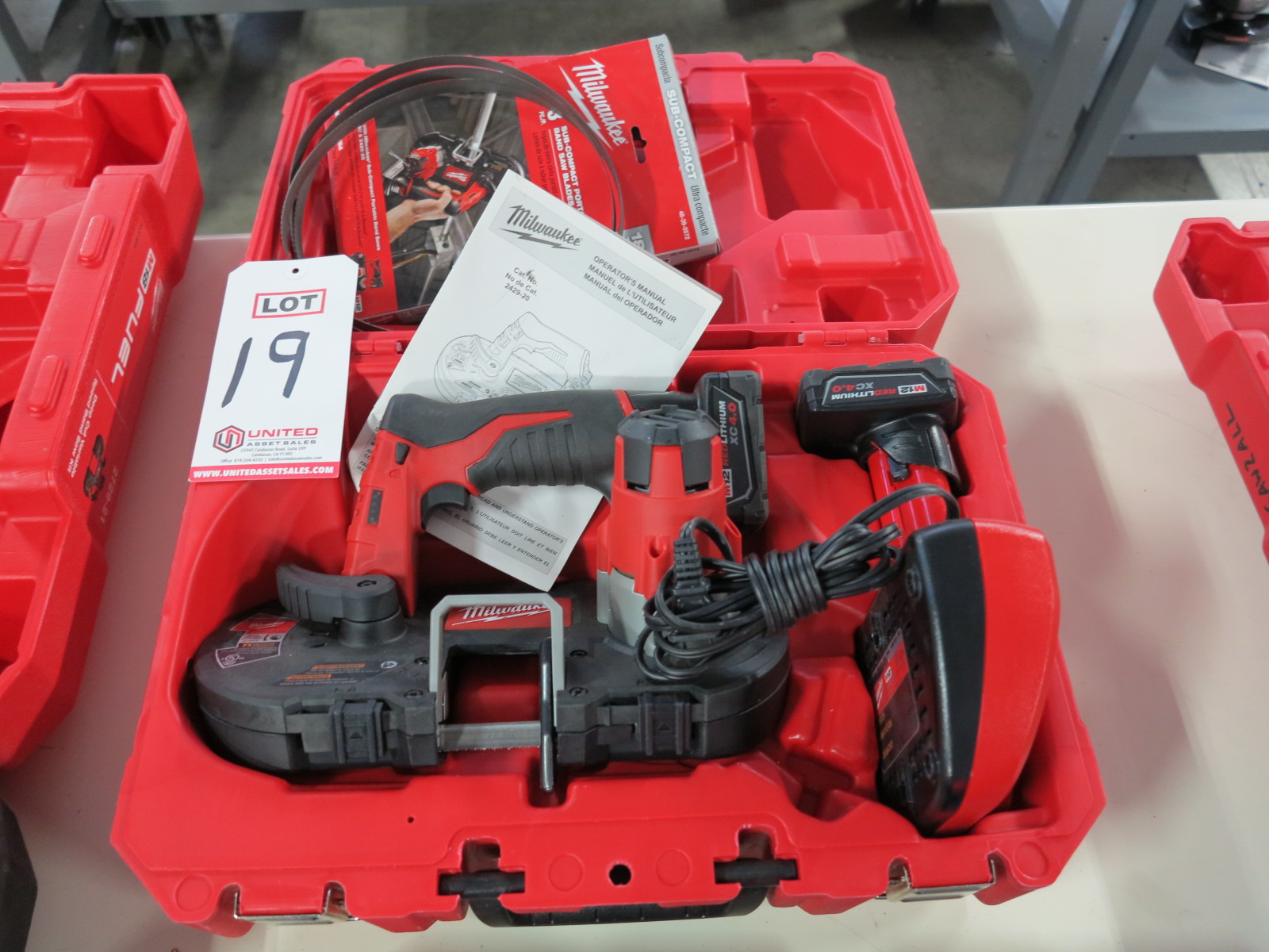 Lot 19 - MILWAUKEE M12 BAND SAW, W/ (2) BATTERIES, CHARGER, CASE, EXTRA BLADES, CAT. NO. 2429-20, 12V