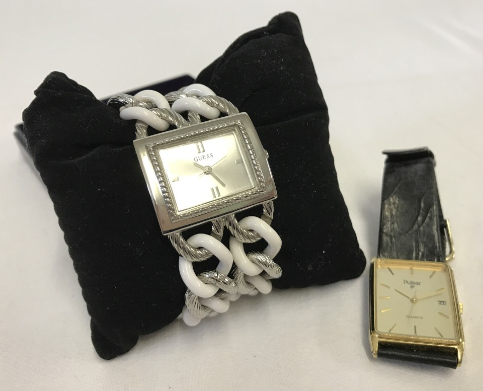 Lot 56 - A ladies Guess watch with silver tone & white chain bracelet.