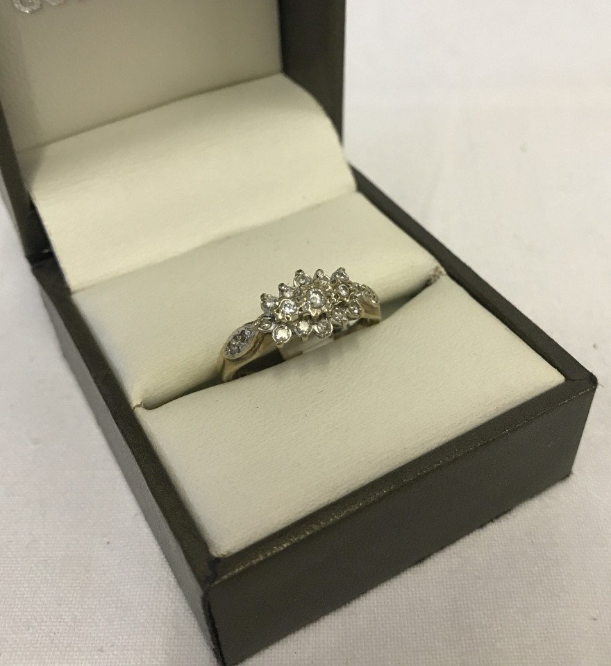 Lot 8 - A hallmarked 9ct yellow gold and 1/4 carat diamond ring.