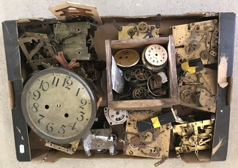 Lot 170 - A box of clock parts and mechanisms.