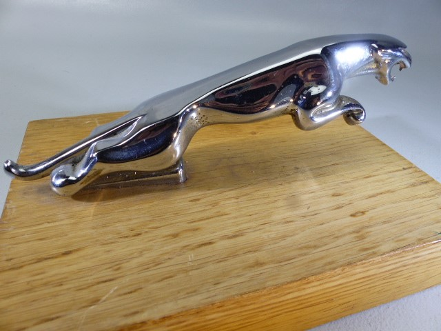 Lot 33 - Chrome Jaguar car mascot on wooden stand