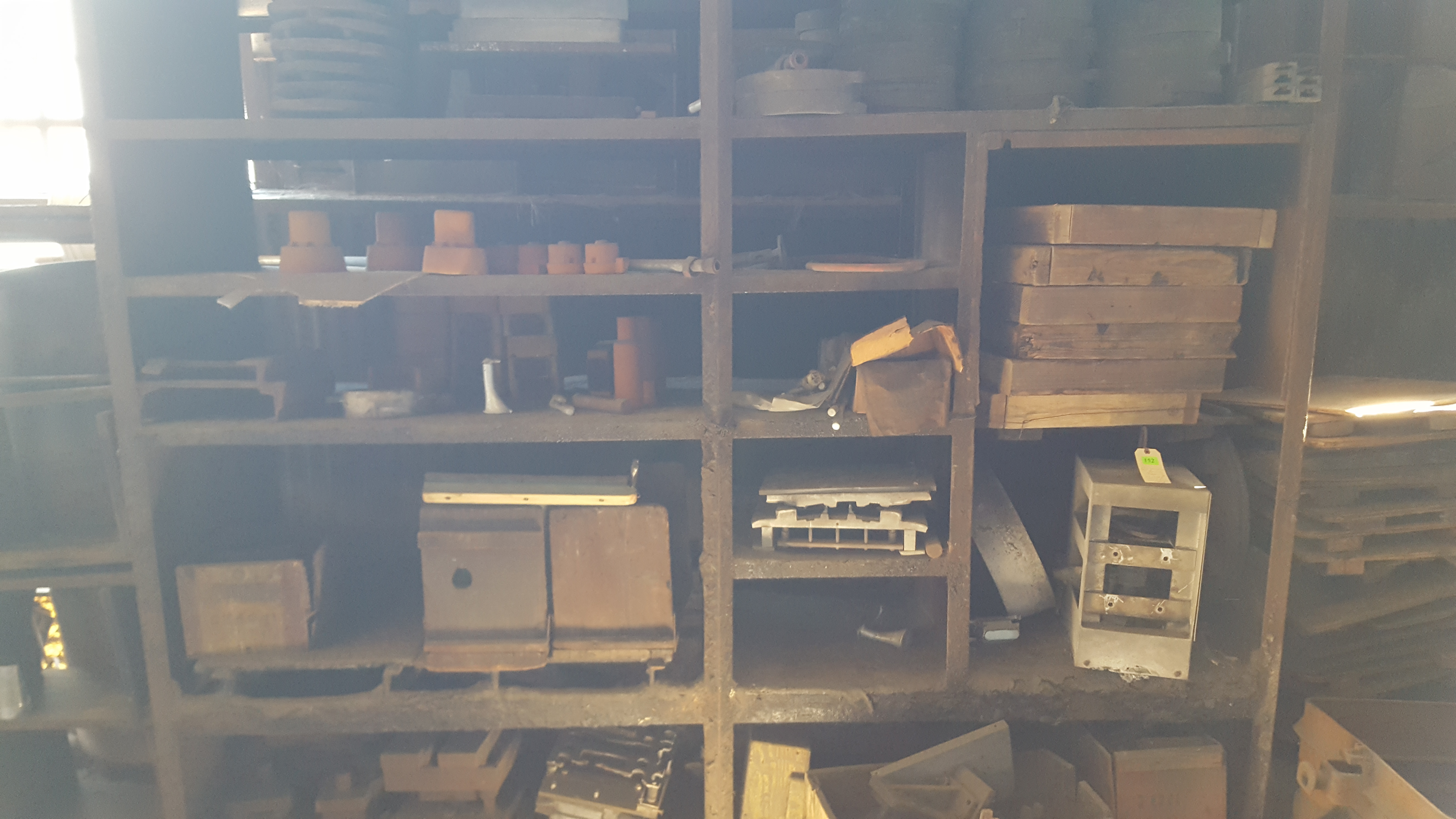 Lot 152 - RACK WITH MOLDS, PARTS, CONTENTS