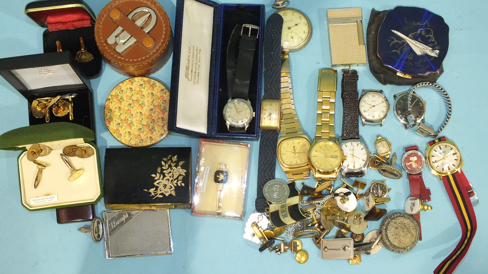 Lot 166 - A plated Dupont lighter and a quantity of wrist watches and cufflinks.