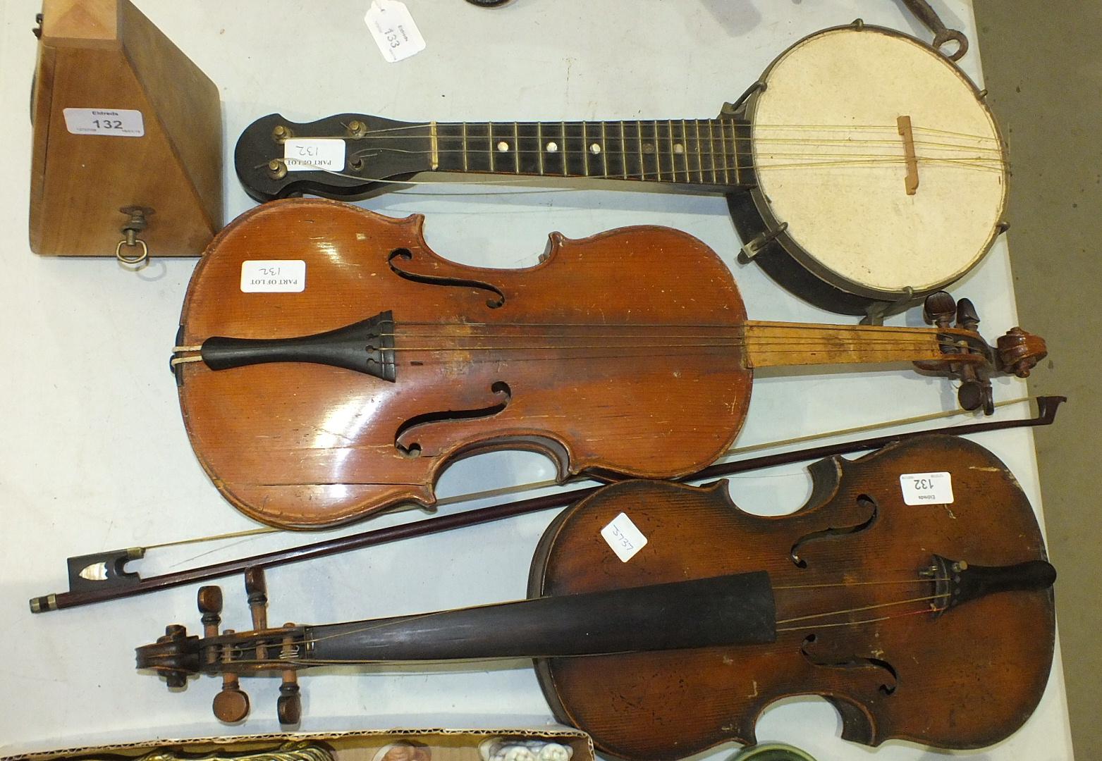 Lot 132 - A full-size violin with paper label, Apres Guarelagnini Lorengo, another violin, a bow, a small