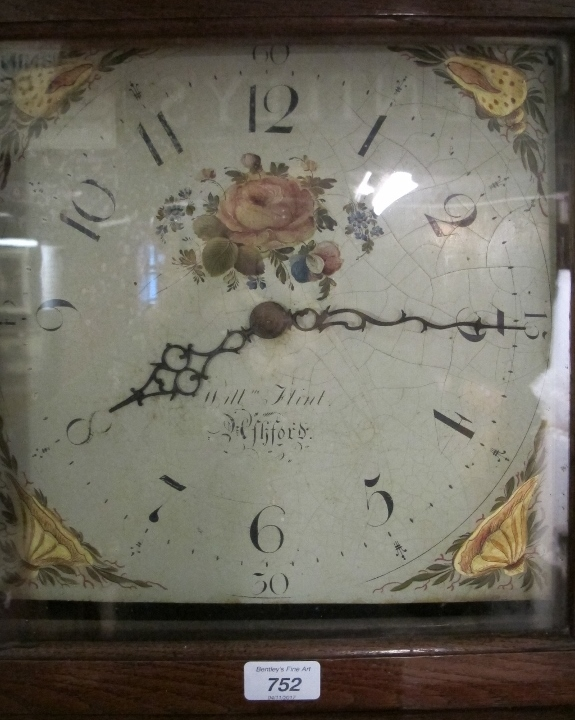 Lot 752 - A c1800 oak cased 30 hour long case clock with painted dial signed William Flint,