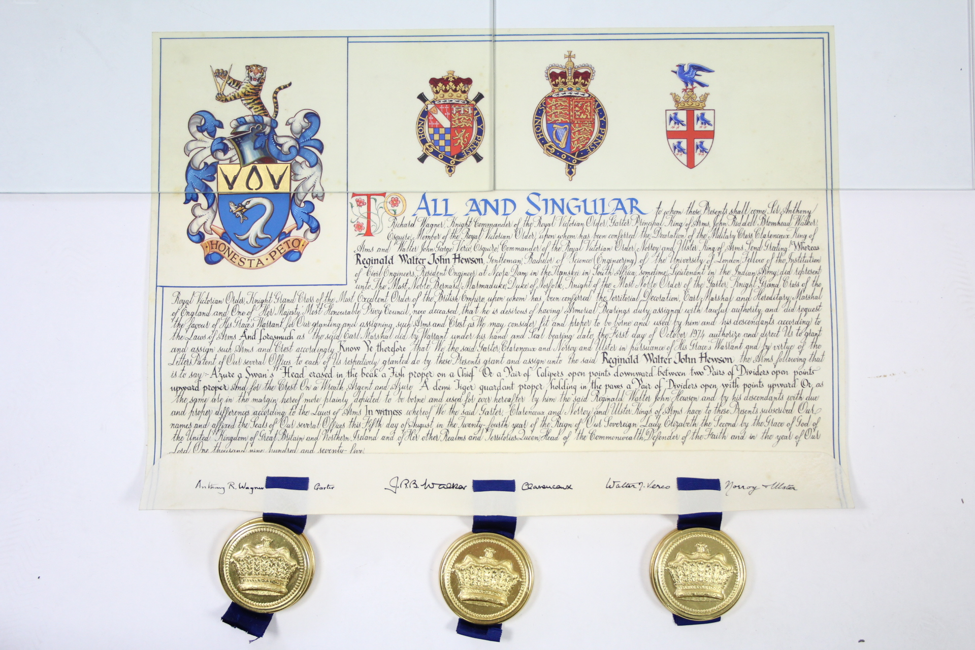Lot 88A - A GRANT OF ARMS on parchment scroll, illustrating the Armorial Bearing granted to Reginald Walter