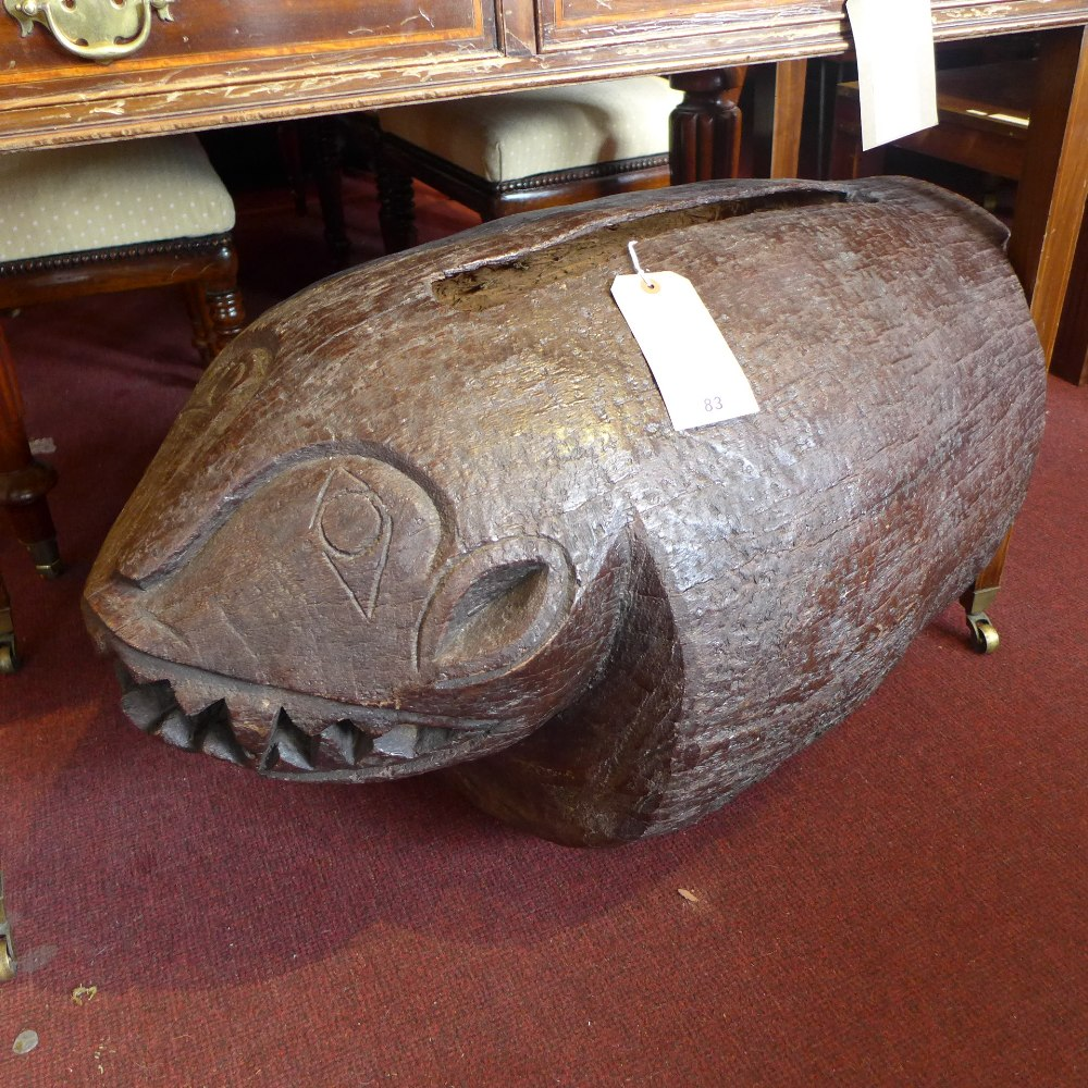 Lot 83 - A 17th Century East Asian tribal drum with carved head. (possibly Cambodian).