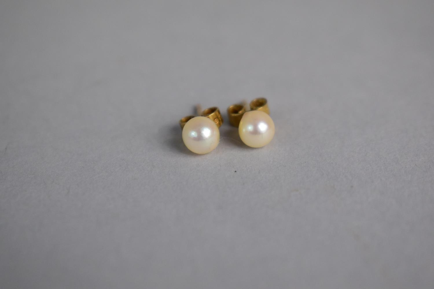 Lot 316 - A Pair of Pearl Earrings Mounted on 9ct Gold Shanks. Each Pearl around 6 Metric Grains.