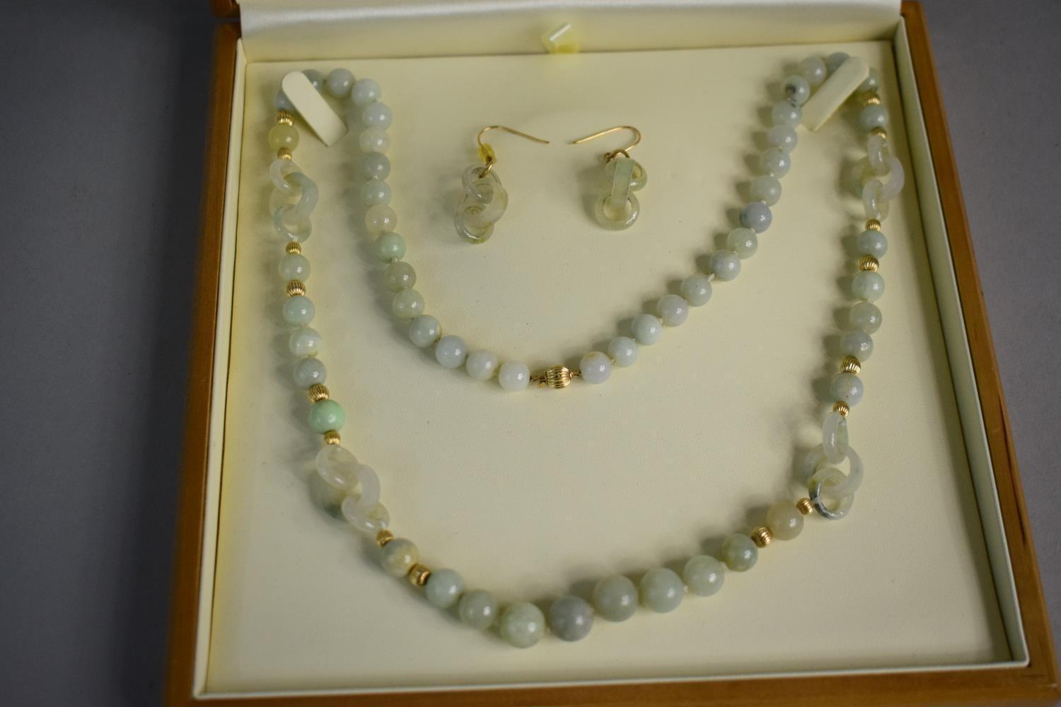 Lot 328 - A Jade and Gold Jewellery Suite Comprising Necklace and Pair of Earrings