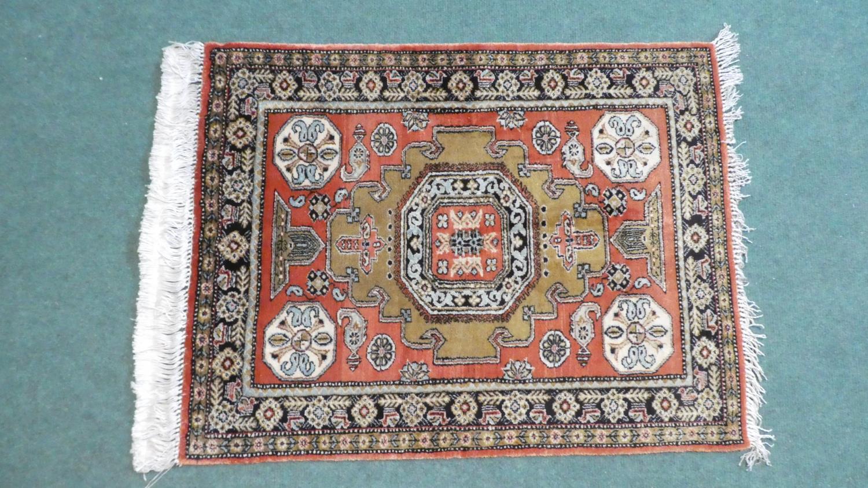 A Persian Hand Made Silk Qum Rug. 74x58