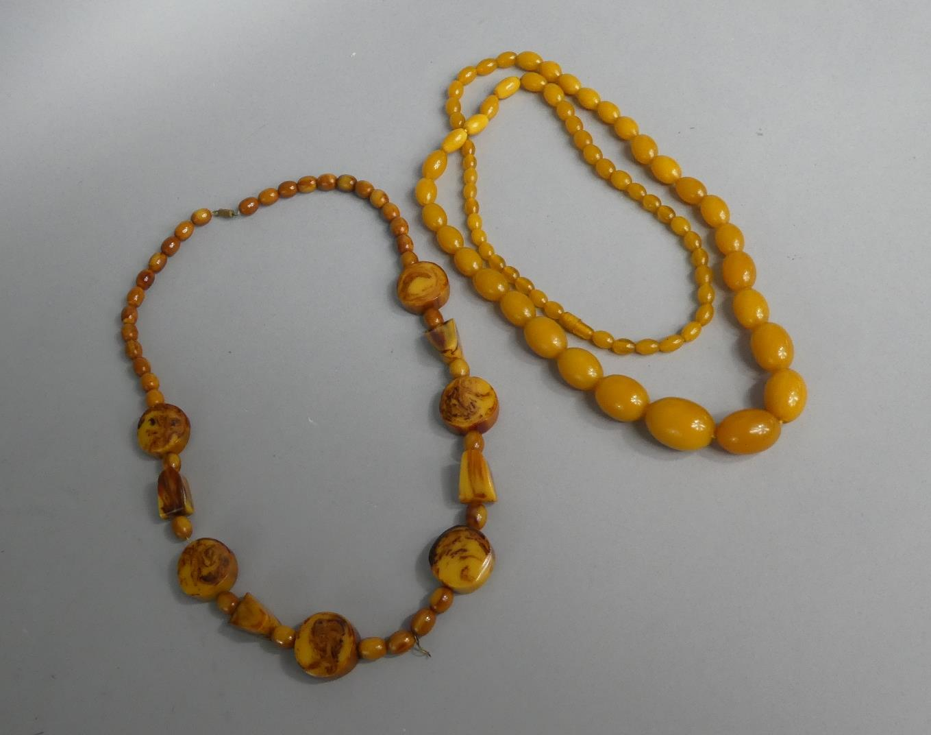 Lot 324 - A Reconstituted Amber Necklace and a Faux 'Butterscotch' Amber Necklace