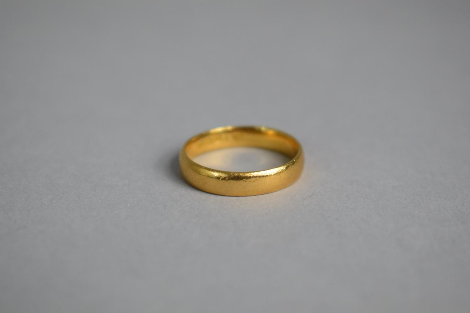 Lot 312 - A 22ct Gold Wedding Band, 3.6gms, Size L.5