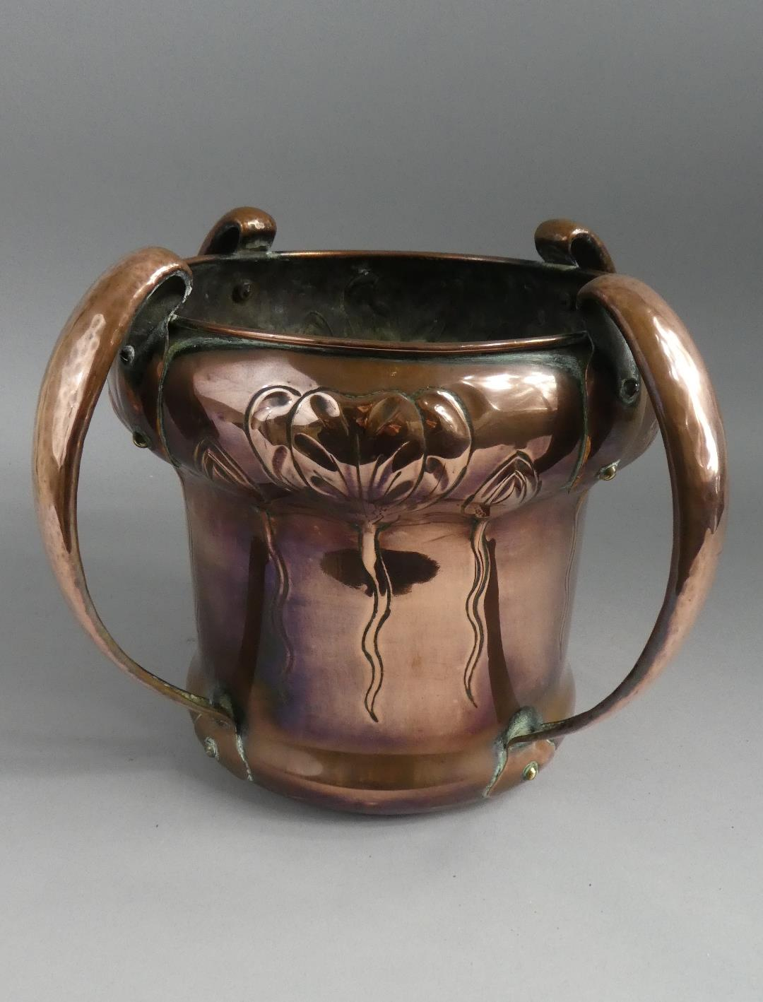Lot 12 - A William Soutter and Sons Arts and Crafts/Art Nouveau Hand Beaten Copper Planter with Four Stylised