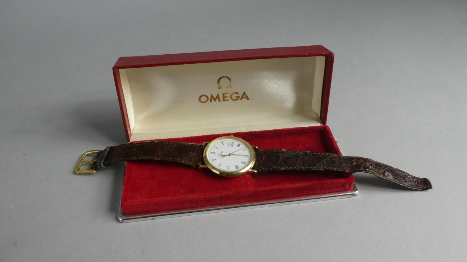 Lot 331 - A 1990s Omega Deville Wrist Watch and Strap, White Face with Roman Numerals and with Date