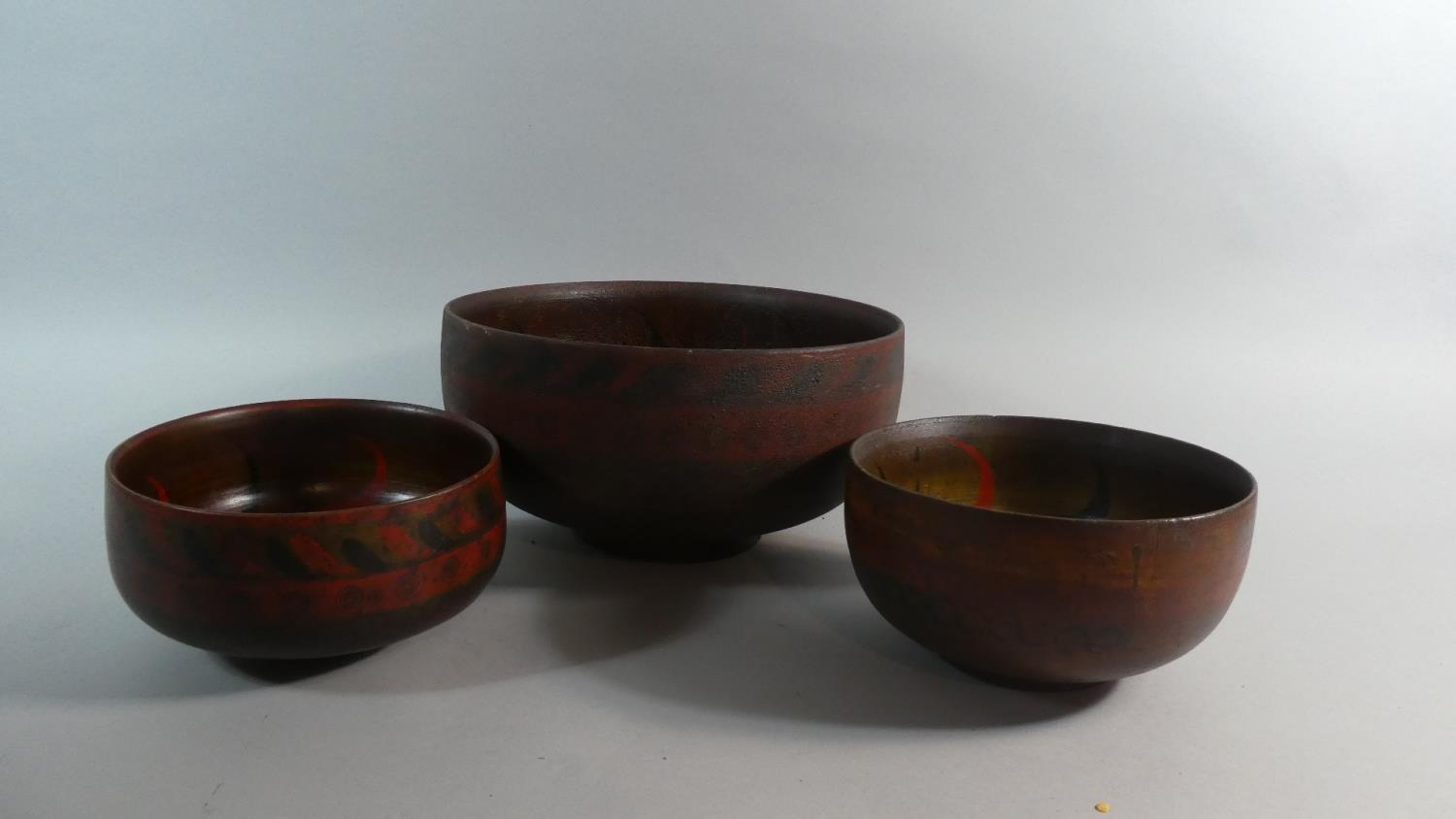 A Collection of Three Early 20th Century Indonesian Wooden Bowls with Original Polychrome Painted
