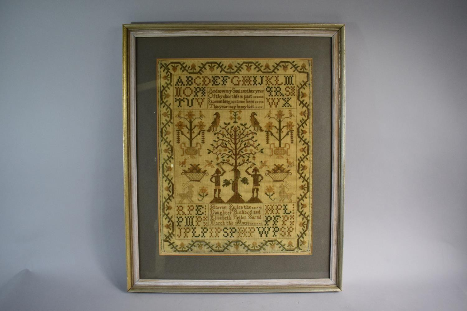 A Framed Early 19th Century Needlework Sampler Depicting Adam and Eve, Snake and Apple Tree Together