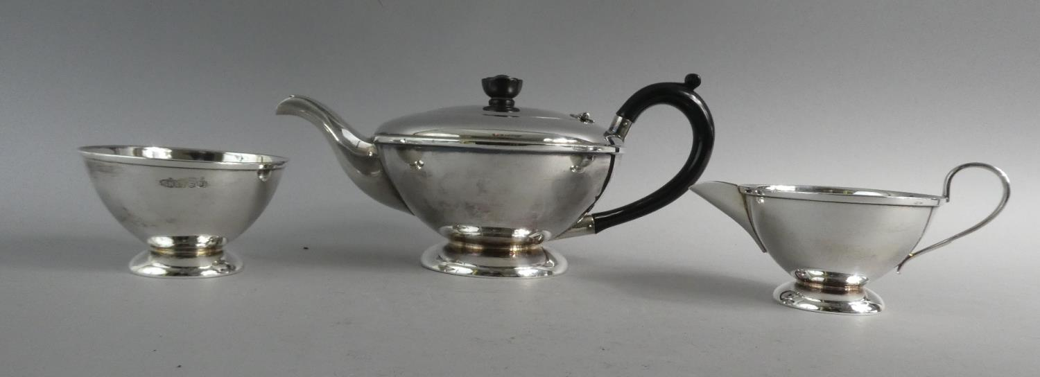 A Silver Three Piece Tea Service, Sheffield 1962. 695gms Total Weight