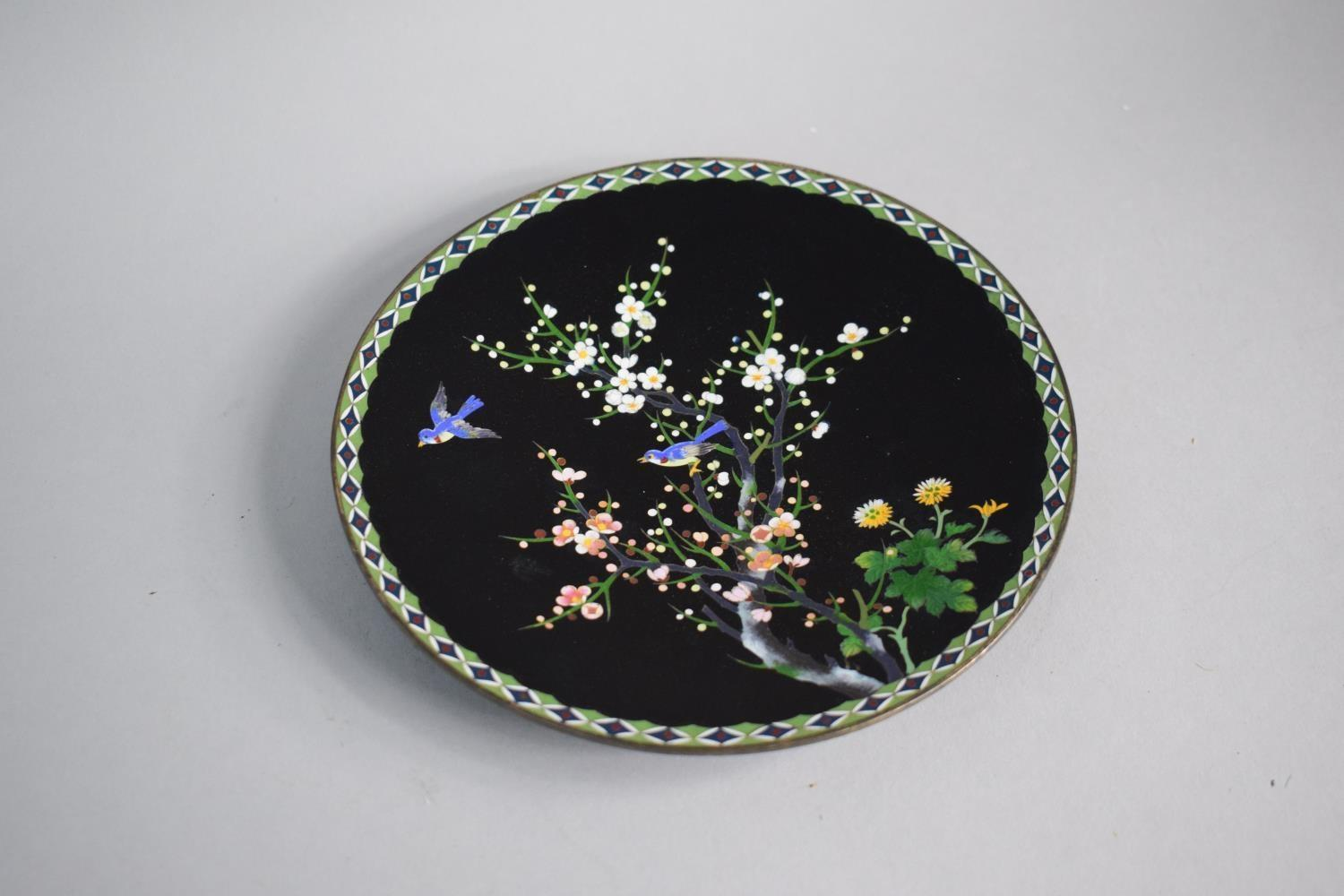 Lot 120 - An Oriental Cloisonne Dish decorated with Blue Birds in Blossom Tree, 18.5cms Diameter