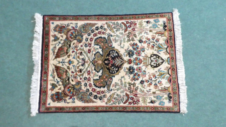 A Persian Hand Made Silk Qum Rug. 77x56cms