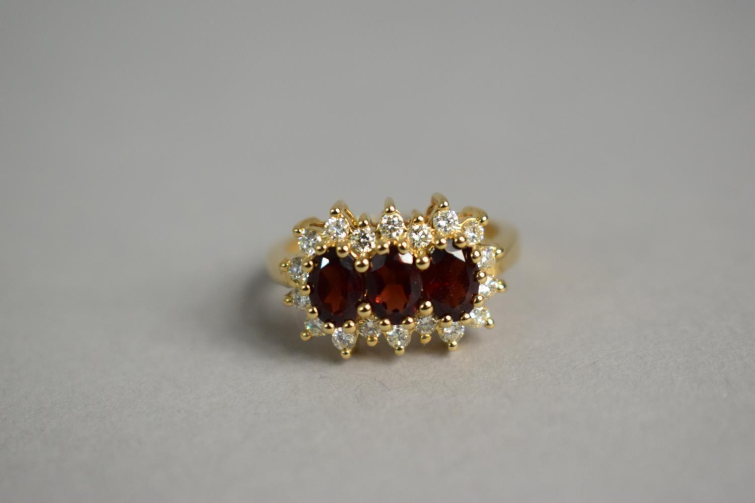 Lot 309 - A 9ct Gold, Diamond and Garnet Cluster Ring, 4.1gms.