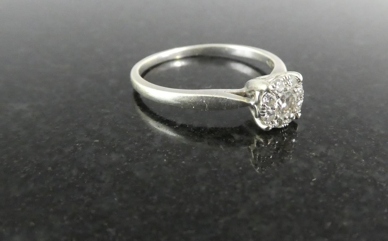 Lot 260 - A Contemporary 9ct Gold and Diamond Cluster Ring, Eight Small Diamonds in Halo Mount Around Centre