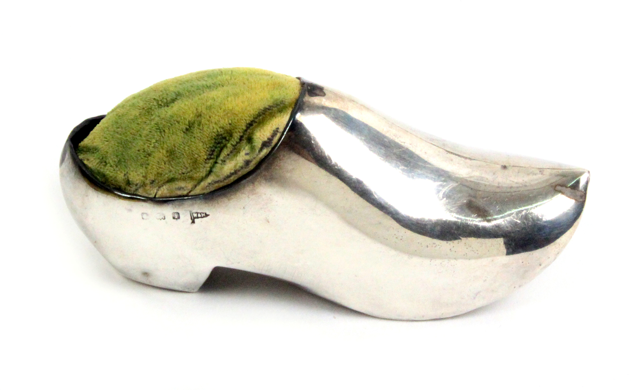 Lot 58 - A silver pin cushion in the form of a Dutch clog, Birmingham, 1908 by Walker and Hall, 10cm