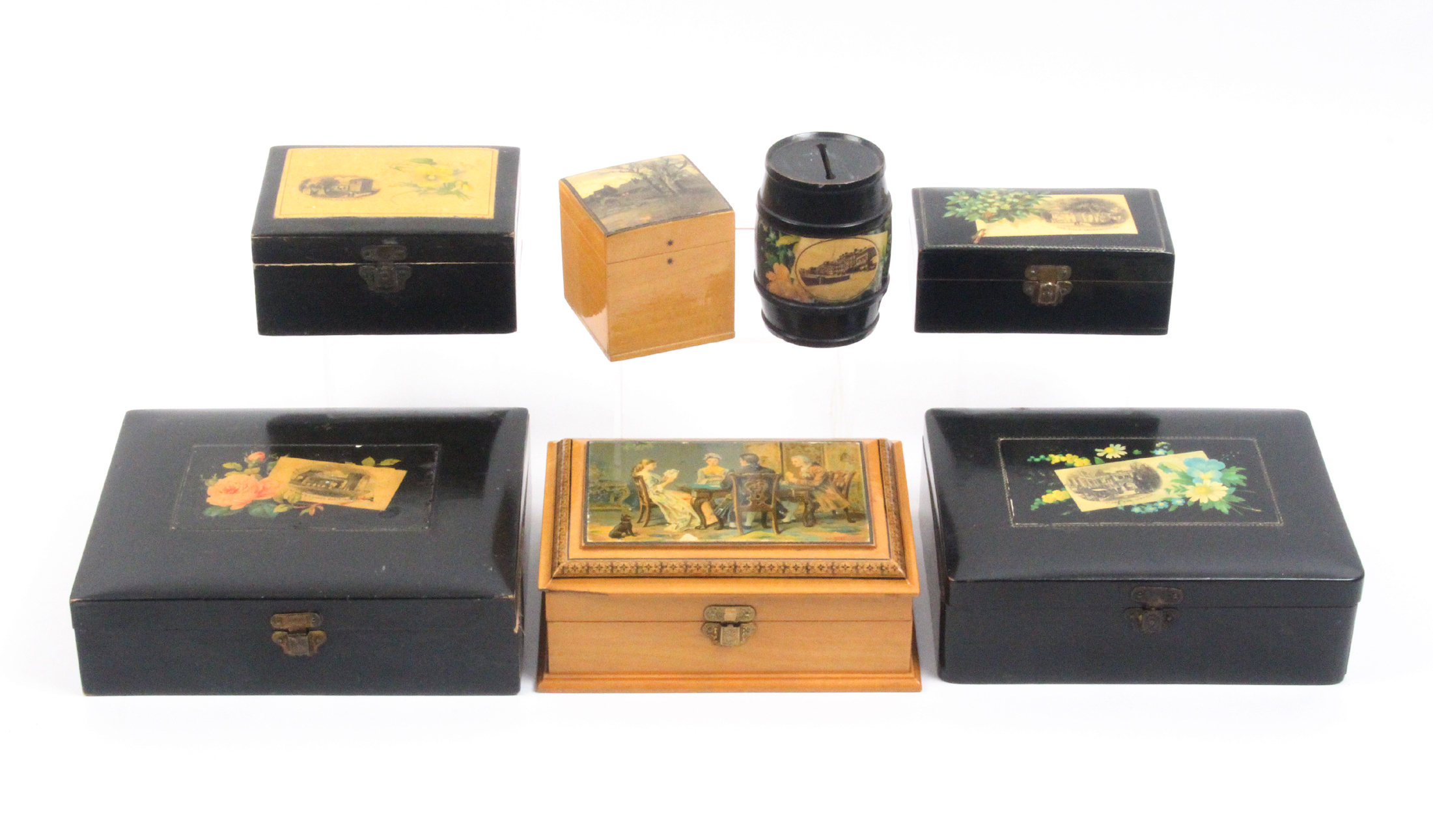 Lot 22 - Mauchline ware - seven pieces comprising two black ground rectangular boxes (flowers - Stone Bow