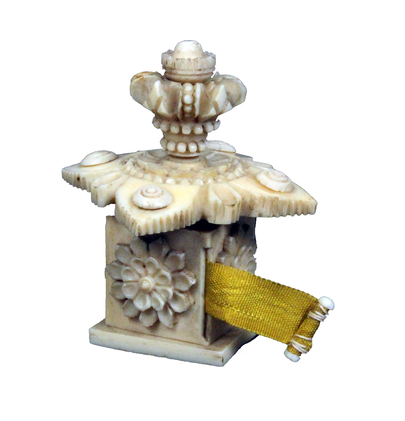 Lot 50 - An elaborate 19th Century ivory tape measure of square form the sides carved with flowers, the