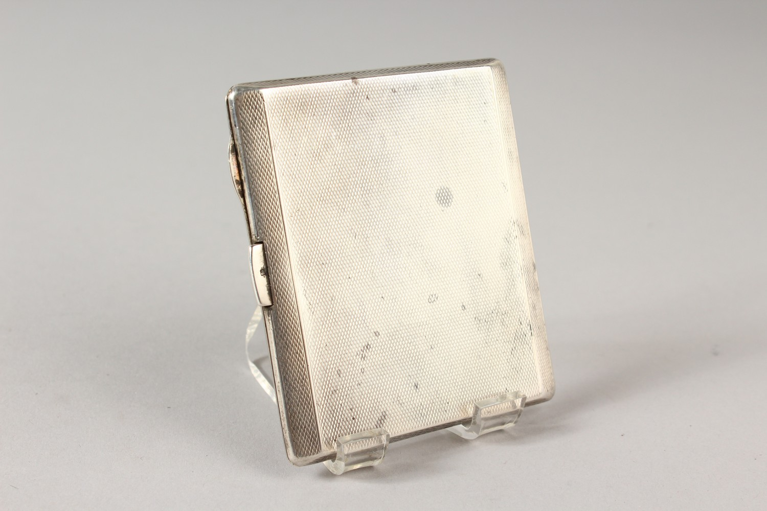 Lot 1775A - AN ENGINE TURNED CIGARETTE CASE, Birmingham 1920, with an enamel of Winston Churchill.