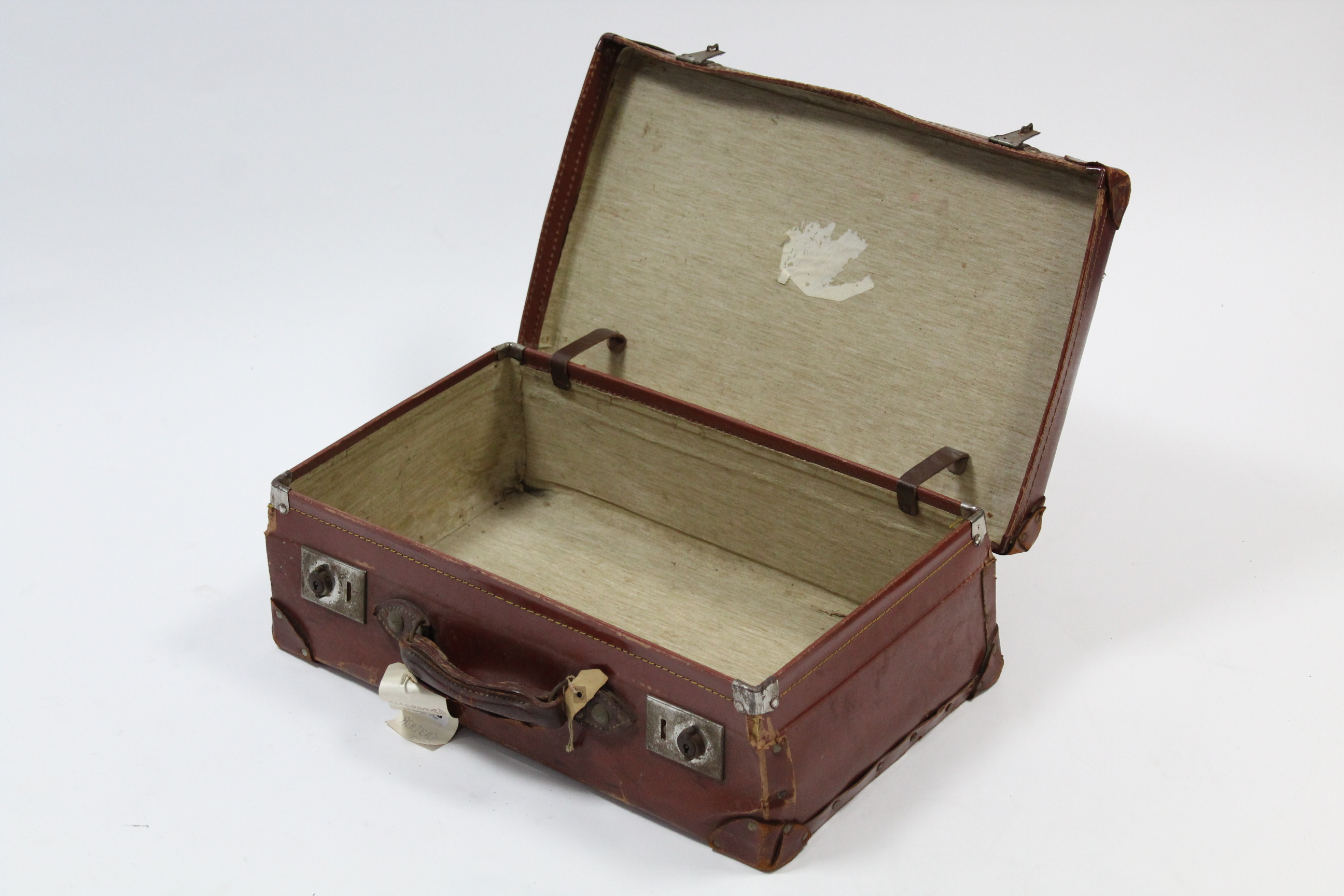 """Lot 218 - A leather suitcase fitted chrome twin-lever locks, 21¾"""" wide."""