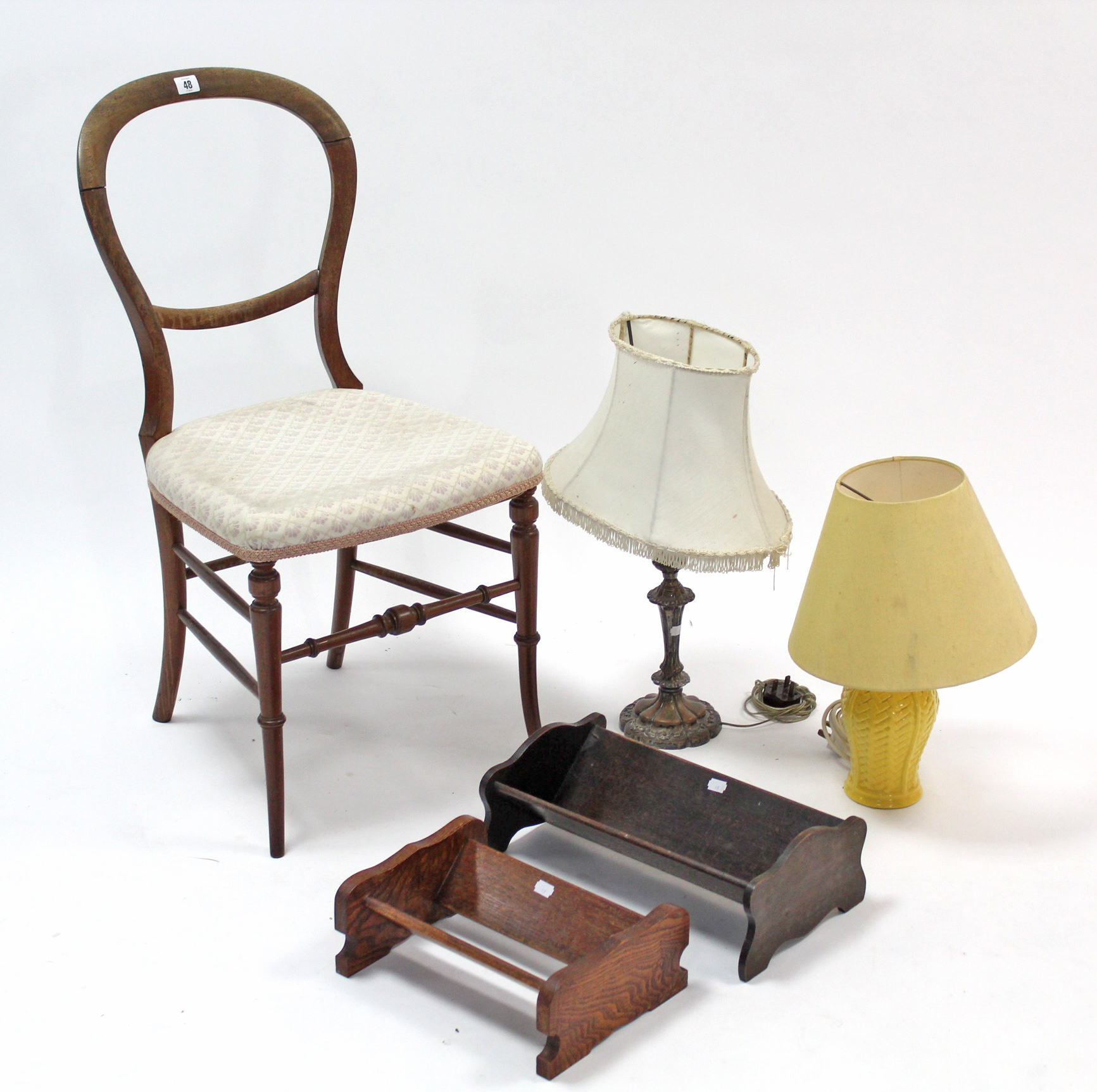 Lot 48 - A balloon-back occasional chair; two book troughs; & two table lamps.