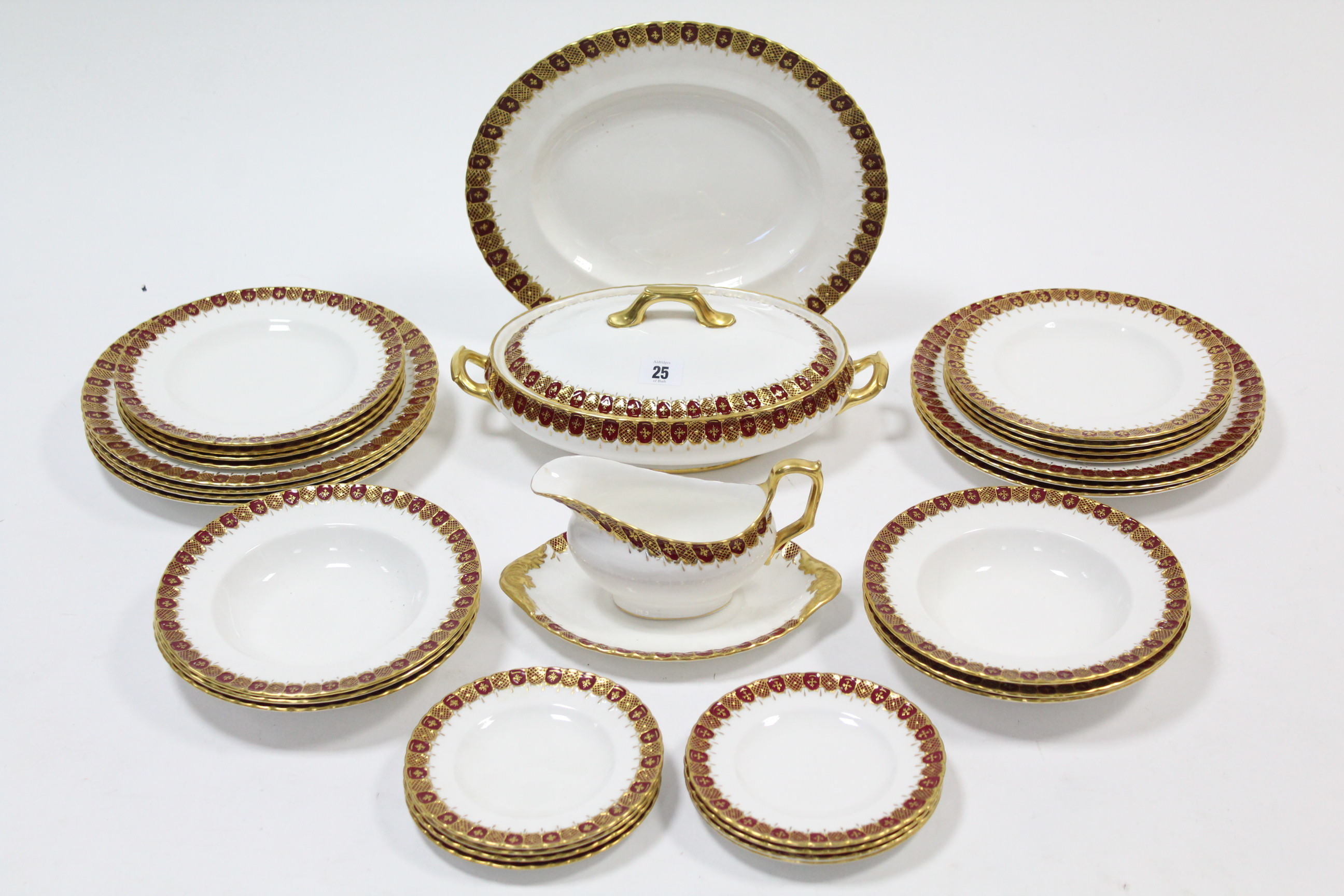 Lot 25 - A Royal Crown Derby thirty-two piece part dinner service of white ground & with crimson & gilt