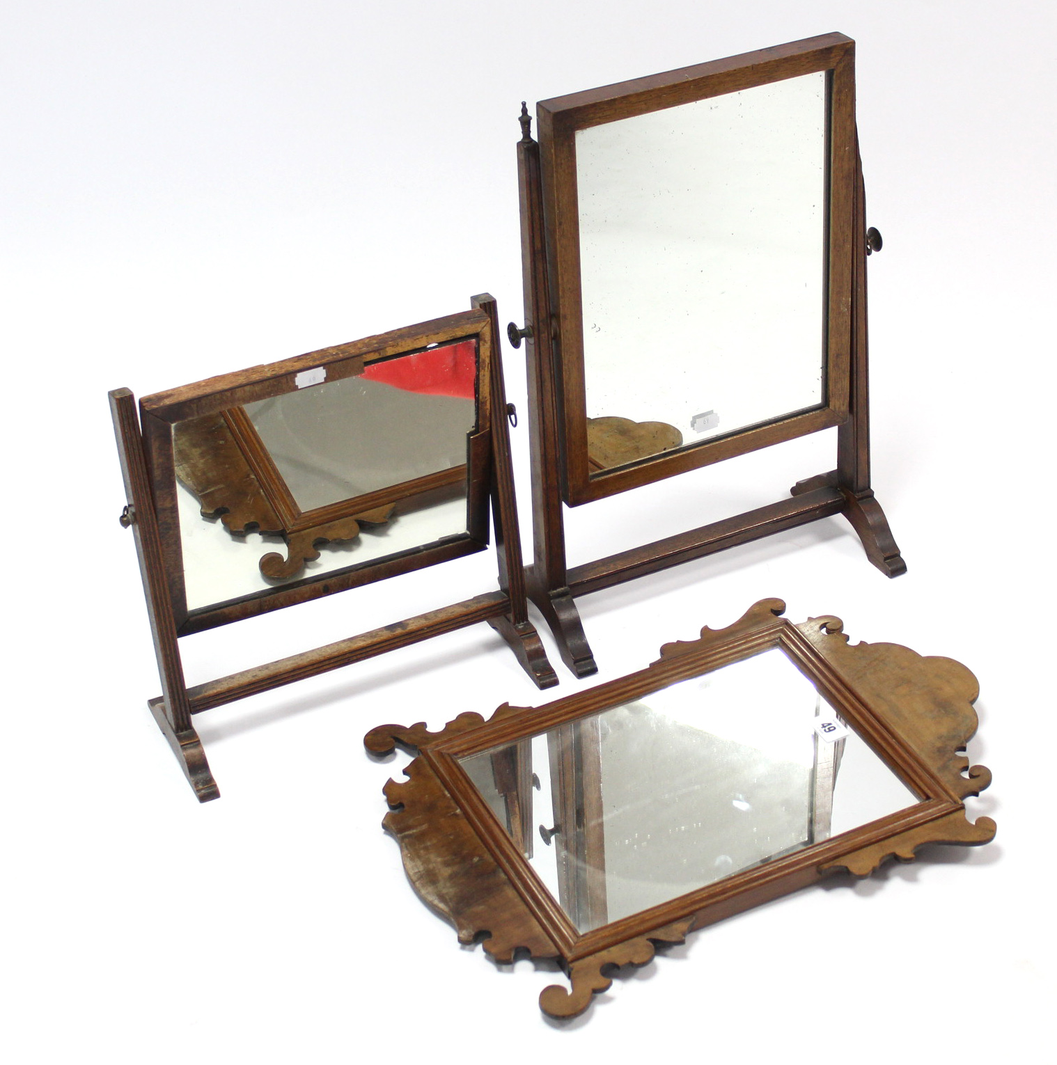 "Lot 49 - A small Swansea-style fretwork frame wall mirror, 19¾"" x 13½""; & two small rectangular swing"