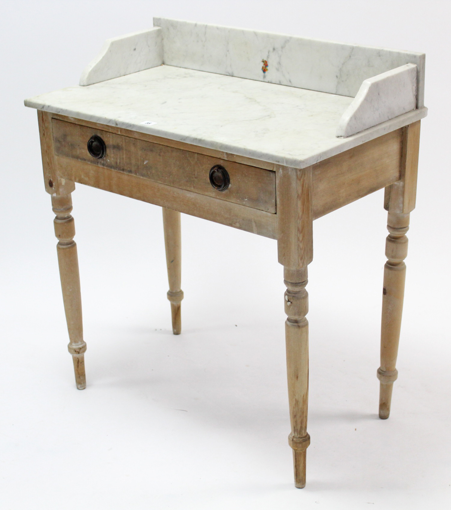 """Lot 38 - A pine marble-top washstand fitted frieze drawer, & on turned tapered legs, 30"""" wide."""