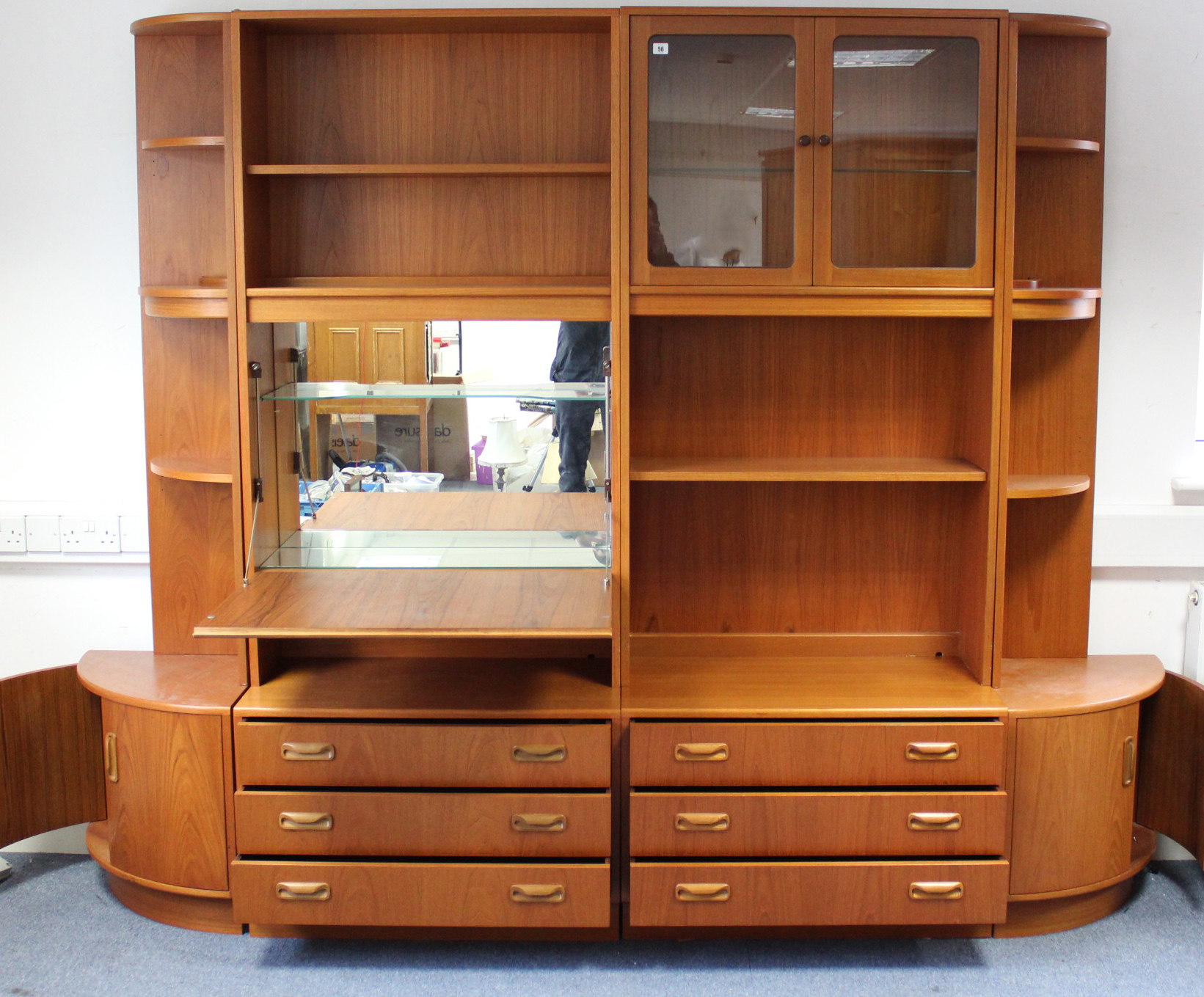 Lot 56 - A G-PLAN TEAK TALL INTER-CHANGEABLE WALL UNIT fitted with an arrangement of drawers, cupboards &