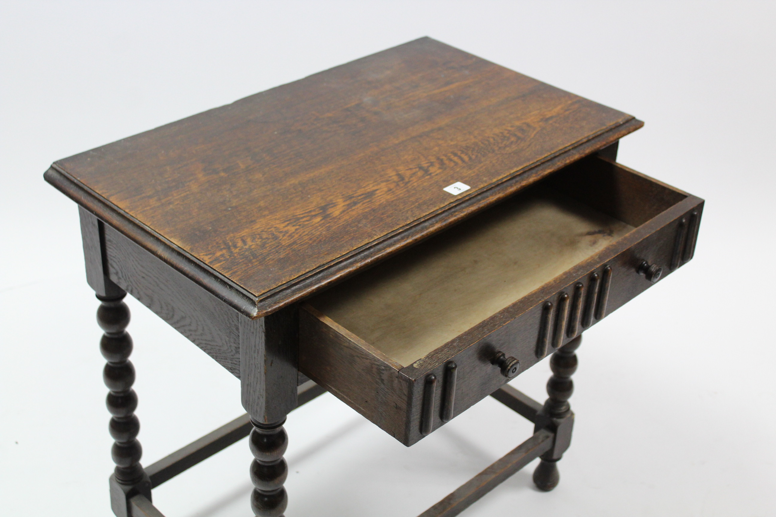 Lot 59 - A 1930's oak side table fitted frieze drawer, & on bobbin-turned legs & turned feet with plain