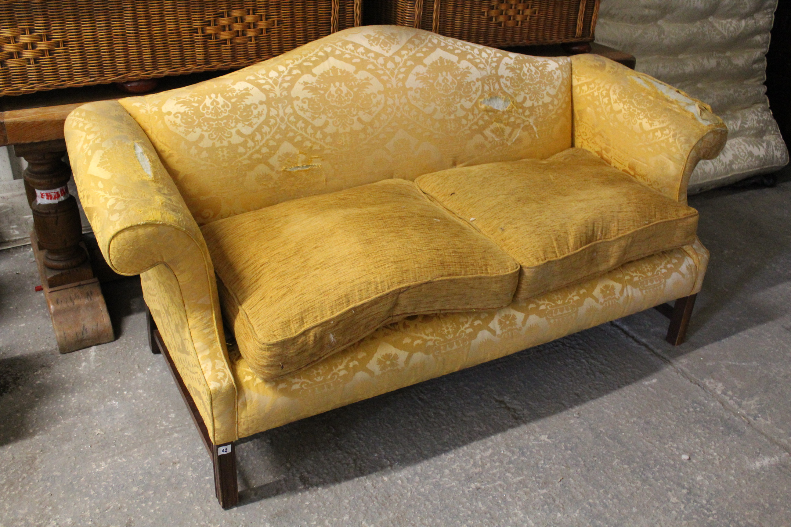 Lot 42 - A Georgian-style three-seater settee (requires reupholstering) with shaped back, scroll-arms &