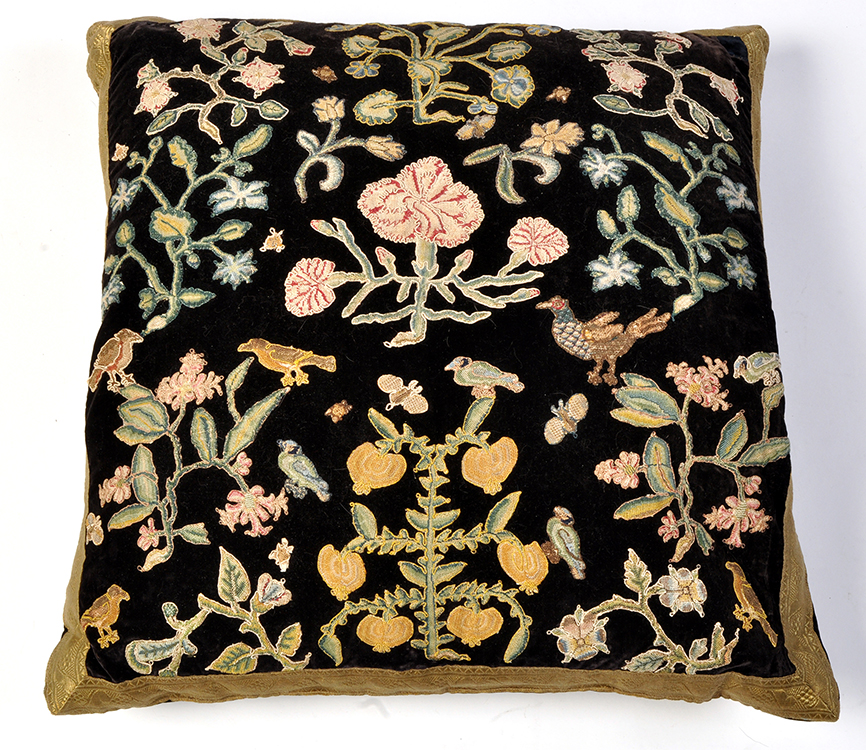 Lot 892 - An antique needlework fragment cushion, decorated with flowers, bugs and birds,