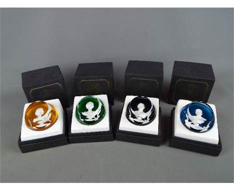 A set of four boxed Baccarat glass cameo paperweights from 'The Royal Cameos In Crystal' series comprising Queen Elizabeth II